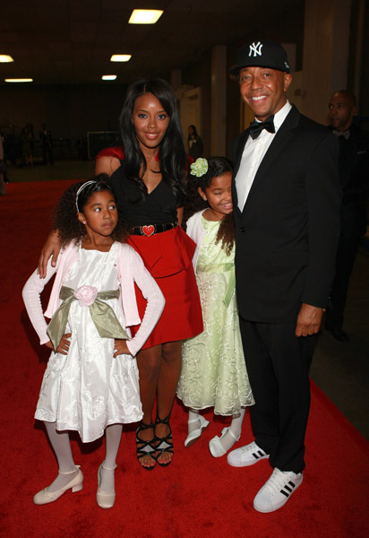 Angela Simmons with her uncle, Russell Simmons, and her cousins, Ming Lee and Aoki Simmons at the 40th NAACP Image Awards, February 2009