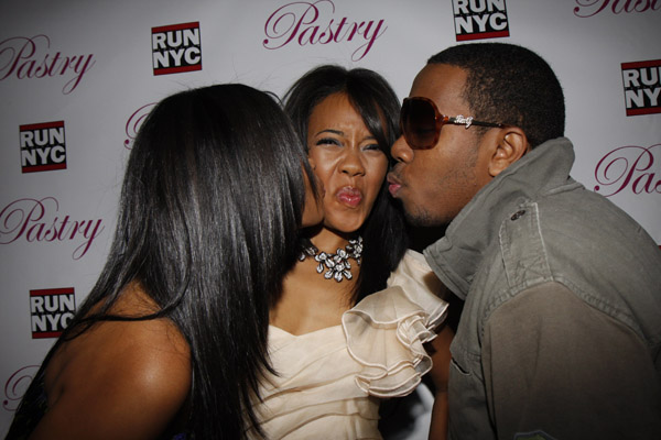 Pastry Shoes designer Angela Simmons at her 21st birthday party, being kissed by siblings JoJo and Vanessa Simmons